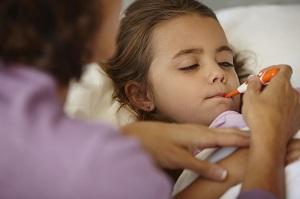 Taking the temperature of sick daughter