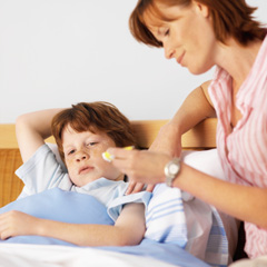 mother taking care of child with flu
