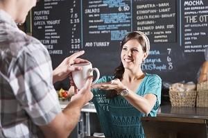 Teen girl working in coffee shop