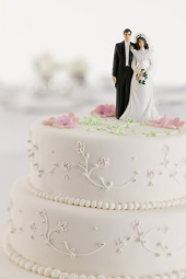 Man and Wife Figurines on Wedding Cake