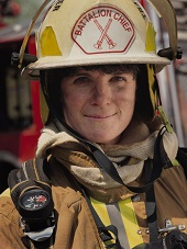 woman firefighter smiling