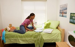young woman in dorm room