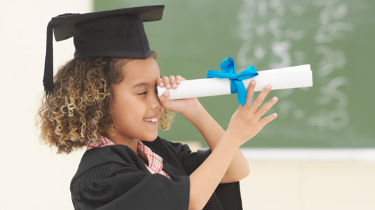 Young Girl Looking Through Diploma